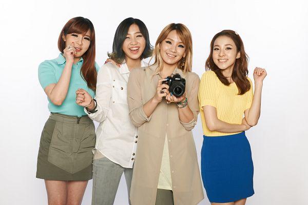 Tags: K-Pop, 2NE1, Sandara Park, Minzy, CL, Park Bom, Light Background, Brown Shirt, Medium Hair, Short Sleeves, Gray Skirt, White Background