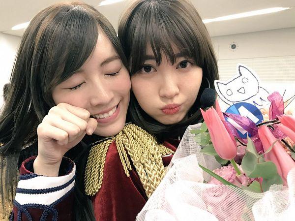 Tags: J-Pop, AKB48, SKE48, Matsui Jurina, Haruna Kojima, Red Jacket, Matching Outfit, Two Girls, Eyes Closed, Pouting, Duo, Fist