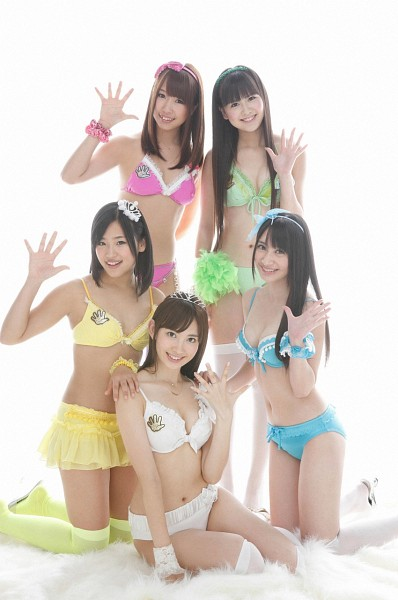 Tags: J-Pop, AKB48, Ishida Haruka, Haruna Kojima, Bikini, Midriff, Yellow Skirt, Socks, Grin, Bare Legs, Wave, Big Breasts