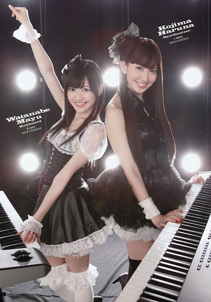 Tags: J-Pop, AKB48, Mayu Watanabe, Haruna Kojima, Hat, Duo, Bare Shoulders, Black Dress, Black Legwear, Bare Legs, Sleeveless, Two Girls