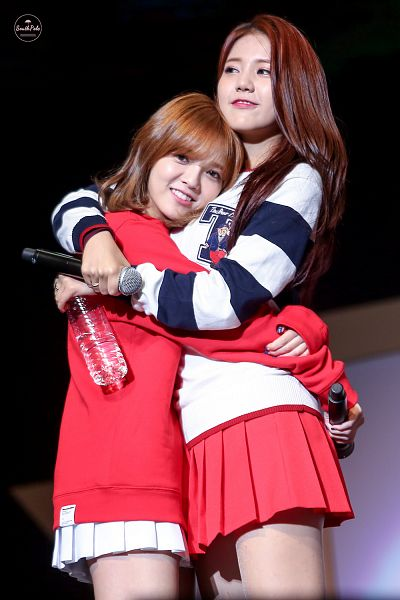 Tags: K-Pop, AOA (Ace Of Angels), Shin Jimin, Shin Hyejeong, Red Skirt, Duo, Arm Around Shoulder, Looking Away, Bottle, Hug, White Skirt, Red Shirt