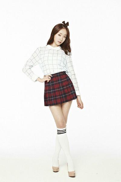 Tags: Baby Kara, Ahn Sojin, White Background, Checkered, Checkered Skirt, Hand On Hip, Knee Socks, White Legwear, Socks, Brown Footwear, Red Skirt, High Heels