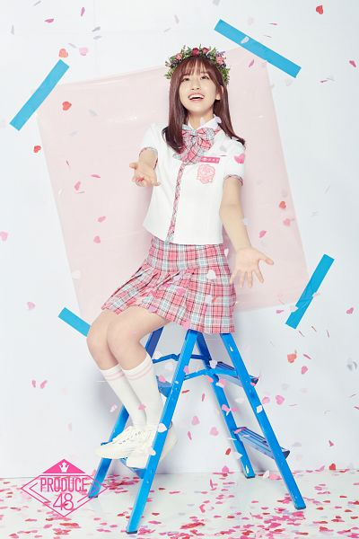 Tags: K-Pop, Television Show, Ahn Yujin, Stairs, Checkered Bow, Confetti, Ladder, Looking Up, Crown, Plaided Print, Flower Crown, Plaided Skirt