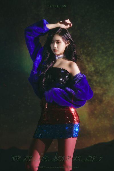 Tags: K-Pop, Everglow, Aisha, Hand On Head, Text: Artist Name, Blue Jacket, Bare Shoulders, Dark Background, Bare Legs, Black Eyes, Multi-colored Dress, Choker