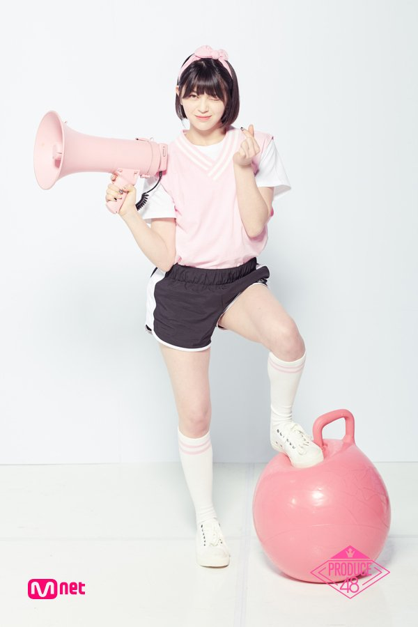 Tags: Television Show, K-Pop, AleXa, Bow, Heart Gesture, Black Shorts, Pink Headwear, Sneakers, White Footwear, Socks, Hair Bow, Light Background