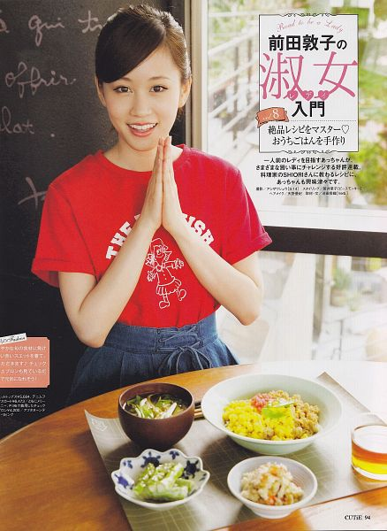 Tags: J-Pop, AKB48, Atsuko Maeda, Skirt, Red Shirt, Denim Skirt, Hair Up, Clasped Hands, Laughing, Rice, Japanese Text, Food