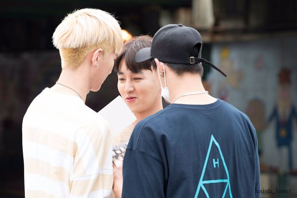 Tags: K-Pop, AxisB, Juno, Daeyoung, Honey, Striped Shirt, Black Headwear, Mask, Holding Object, Striped, Trio, Back