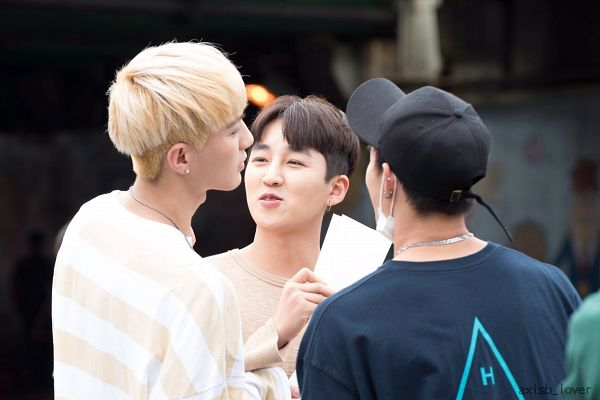 Tags: K-Pop, AxisB, Daeyoung, Honey, Juno, Holding Object, Back, Looking Up, Looking At Another, Eyes Half Closed, Blue Shirt, Face Mask