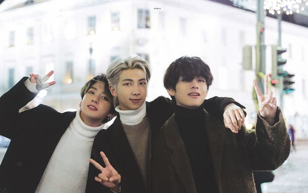 Tags: K-Pop, BTS, Jungkook, V (Kim Taehyung), Rap Monster, Three Males, Black Eyes, Brown Outerwear, Coat, Turtleneck, V Gesture, Arm Around Shoulder