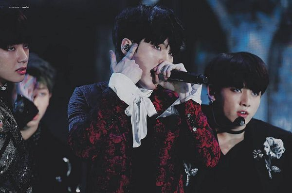 Tags: K-Pop, BTS, Jungkook, V (Kim Taehyung), Suga, Red Jacket, Black Eyes, Floral Print, Three Males, Floral Jacket, Earbuds, Dancing