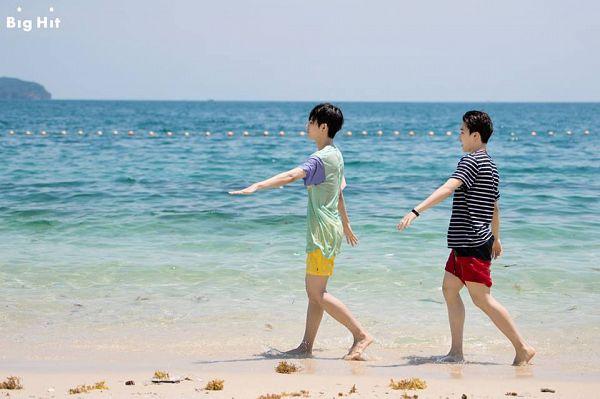 Tags: K-Pop, BTS, V (Kim Taehyung), Park Jimin, Beach, Duo, Outdoors, Walking, Sand, Short Sleeves, Yellow Shorts, Side View