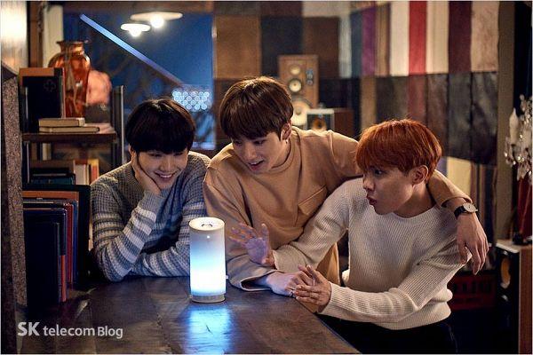 Tags: K-Pop, BTS, Suga, Jungkook, J-Hope, Trio, Arm Around Shoulder, Grin, Three Males, Lamp, Red Hair, Watch