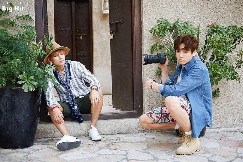 Tags: K-Pop, BTS, Jungkook, V (Kim Taehyung), Denim Jacket, Shorts, Crouching, Serious, Hat, Two Males, White Footwear, Ring