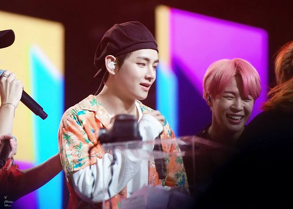 Tags: K-Pop, BTS, V (Kim Taehyung), Park Jimin, Hat, Floral Print, Duo, Floral Jacket, Earbuds, Two Males, Orange Outerwear, Pink Hair