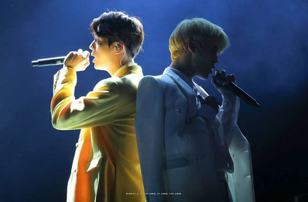 Tags: K-Pop, BTS, Park Jimin, Jin, Side View, Singing, White Pants, White Outerwear, Two Males, Duo, Yellow Outerwear, Earbuds