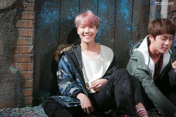 Tags: K-Pop, BTS, J-Hope, Jin, Coat, Two Males, Pink Hair, Green Outerwear, Black Pants, Fur, Duo, Grin