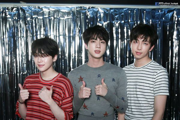 Tags: K-Pop, BTS, Rap Monster, Suga, Jin, Indoors, Head Tilt, Trio, Sweater, Grin, Red Shirt, Text: URL