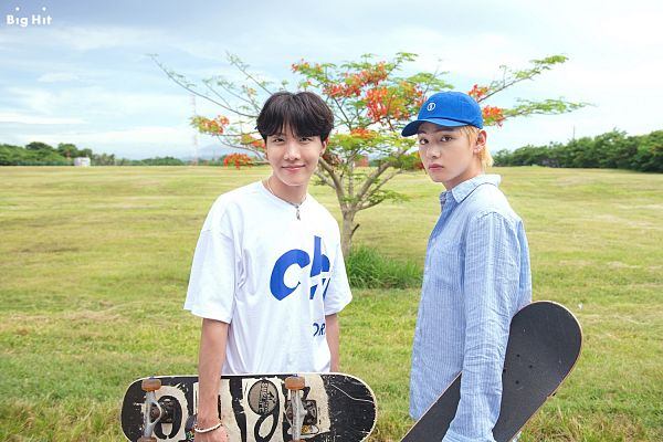 Tags: K-Pop, BTS, V (Kim Taehyung), J-Hope, Grass, Blue Shirt, Two Males, Necklace, Collar (Clothes), Blue Headwear, Day, Hat
