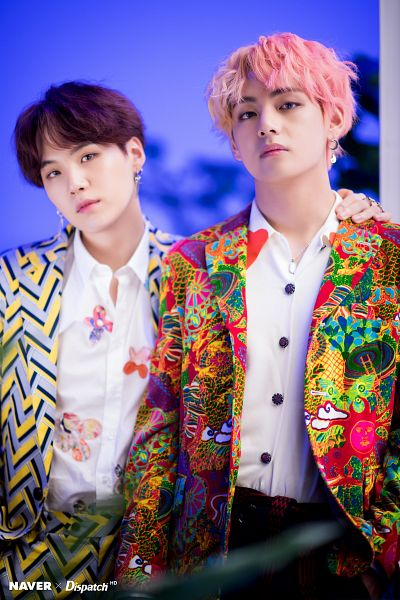 Tags: K-Pop, BTS, V (Kim Taehyung), Suga, Wavy Hair, Necklace, Multi-colored Hair, Serious, Suit, Duo, English Text, Head Tilt