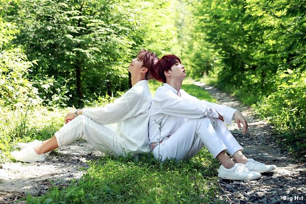 Tags: K-Pop, BTS, Suga, Rap Monster, Sitting On Ground, White Pants, Outdoors, English Text, Plant, Duo, Bush, Road