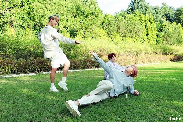 Tags: K-Pop, BTS, Park Jimin, Suga, Jungkook, Pink Hair, Plant, Bush, English Text, Laying On Side, Tree, Text: Company Name