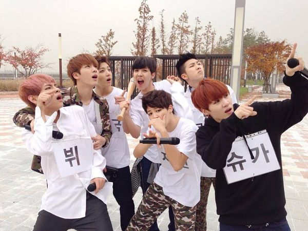 Tags: K-Pop, BTS, Suga, Jungkook, Jin, V (Kim Taehyung), Rap Monster, Park Jimin, J-Hope, Pointing, Camouflage Print, Red Hair