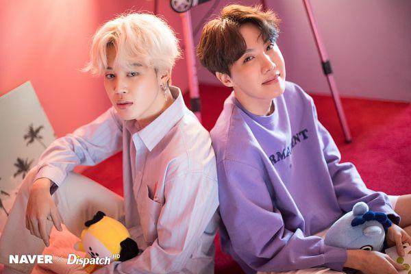 Tags: K-Pop, BTS, Park Jimin, J-Hope, Duo, Stuffed Toy, Serious, Back To Back, Two Males, Blue Shirt, Stuffed Animal, Purple Shirt