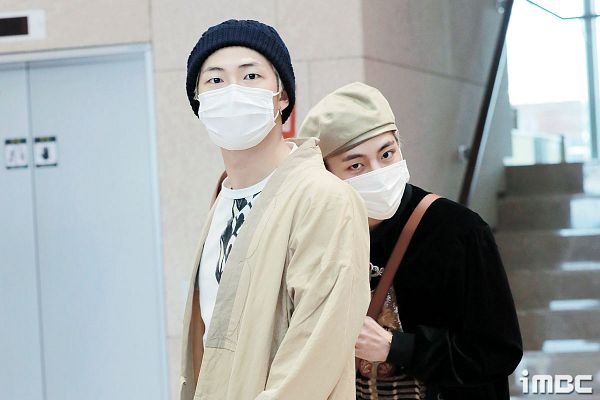 Tags: K-Pop, BTS, V (Kim Taehyung), Rap Monster, Close Up, Sweater, Duo, Black Headwear, Headdress, Two Males, Black Eyes, Airport