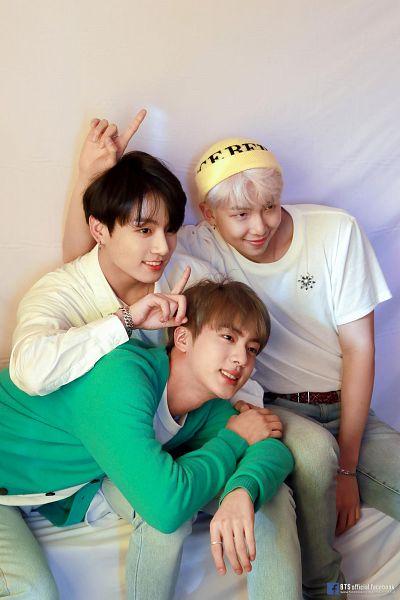 Tags: K-Pop, BTS, Jungkook, Jin, Rap Monster, Text: URL, White Hair, Bracelet, Yellow Headwear, Ring, Laying On Stomach, Gray Pants