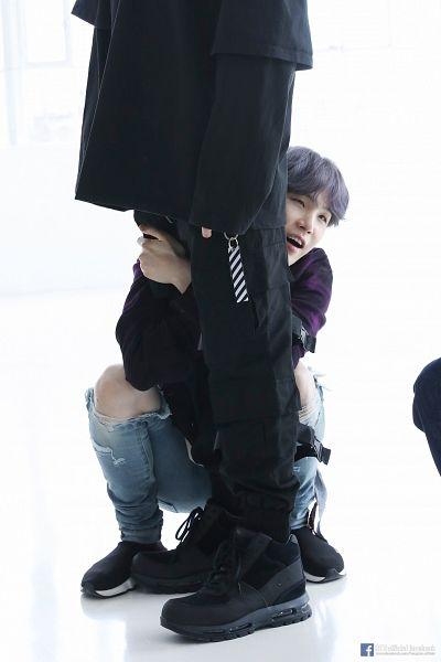 Tags: K-Pop, BTS, Suga, Jungkook, Ripped Pants, Black Footwear, White Background, Text: URL, Purple Hair, Looking Ahead, Hug, Holding Close