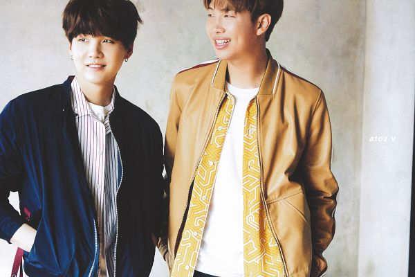 Tags: K-Pop, BTS, Rap Monster, Suga, Blue Jacket, Duo, Japanese Text, Blue Outerwear, Two Males, Yellow Outerwear, Grin, Magazine Scan