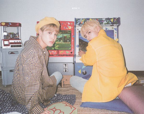 Tags: K-Pop, BTS, V (Kim Taehyung), Park Jimin, Jeans, Indoors, Yellow Outerwear, Brown Outerwear, Serious, Videogames, Blue Pants, Checkered