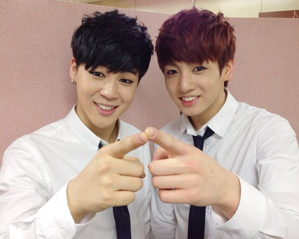 Tags: K-Pop, BTS, Jungkook, Park Jimin, Pointing, Duo, Grin, Black Neckwear, Red Hair, Two Males, Tie, Matching Outfit