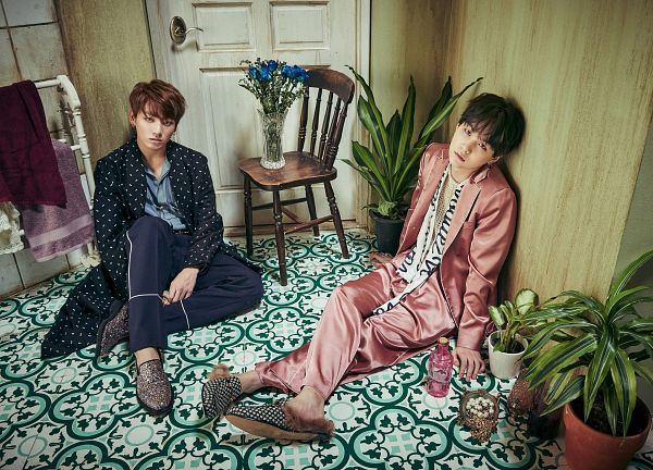 Tags: K-Pop, BTS, Jungkook, Suga, Plant, Pink Outfit, Striped Shirt, Striped, Leaning Back, Black Outfit, Two Males, Duo