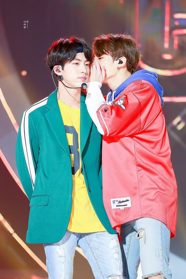 Tags: K-Pop, BTS, Jungkook, Jin, Holding Close, Stage, Duo, Hood, Two Males, Yellow Shirt, Hoodie, Red Shirt