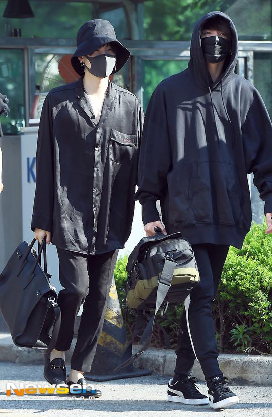 Tags: K-Pop, BTS, Jungkook, Suga, Black Pants, Black Headwear, Hood, Outdoors, Headdress, Plant, Hood Up, Mask
