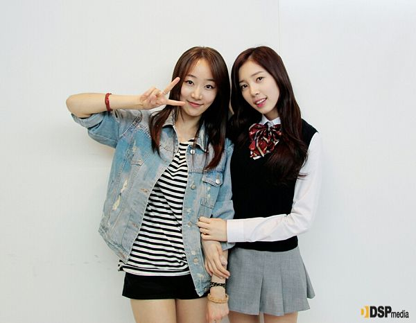 Tags: K-Pop, Baby Kara, Yoon Chaekyung, Ahn Sojin, Striped, Black Skirt, Two Girls, Light Background, Duo, White Background, Denim Jacket, V Gesture