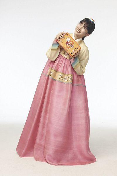 Tags: K-Pop, Miss A, Bae Suzy, Skirt, Yellow Shirt, Box, Pink Skirt, Hair Up, Head Tilt, Light Background, Traditional Clothes, White Background