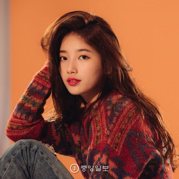 Tags: K-Pop, Miss A, Bae Suzy, Black Eyes, Simple Background, Red Lips, Sitting, Bent Knees, Orange Background, Jeans, Pants, Hand On Head