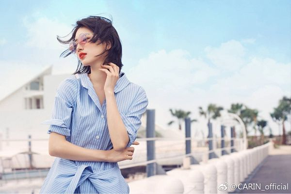 Tags: K-Pop, Miss A, Bae Suzy, Standing, Sky, Blue Shirt, Wind, Short Hair, Flowing Hair, Red Lips, Glasses, Rolled Up Sleeves