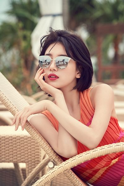 Tags: K-Pop, Miss A, Bae Suzy, Sunglasses, Orange Outfit, Sleeveless, Orange Dress, Bent Knees, Bare Shoulders, Short Hair, Red Lips, Sitting