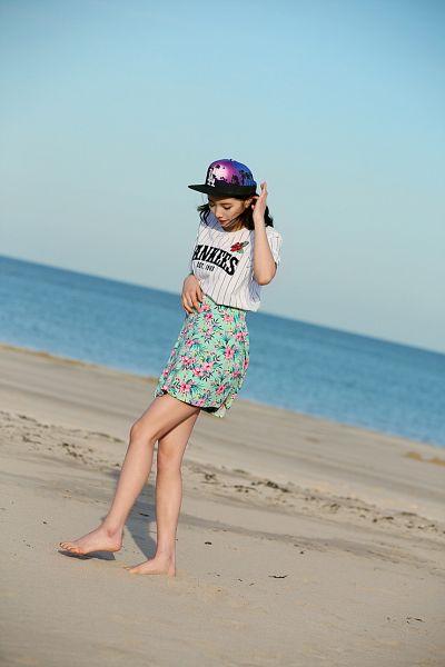Tags: K-Pop, Miss A, Bae Suzy, Skirt, Looking Down, Floral Skirt, Sky, Striped Shirt, Water, Black Headwear, Sea, Striped