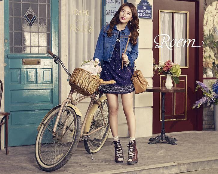 Tags: K-Pop, Bae Suzy, Blue Outfit, Bicycle, Grin, Blue Jacket, Vase, Red Lips, Wavy Hair, Head Tilt, Blue Flower, Denim Jacket