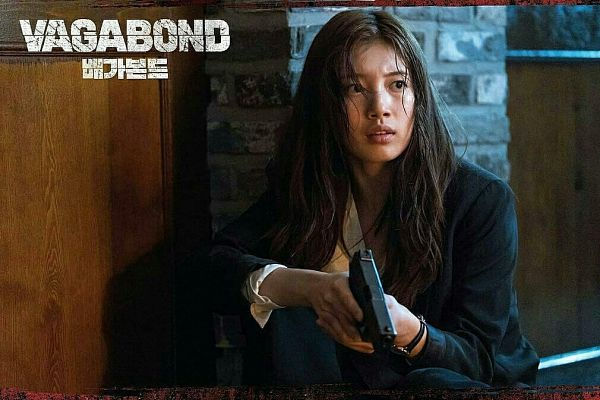 Tags: K-Pop, K-Drama, Bae Suzy, Text: Series Name, Black Jacket, Crouching, Weapons, English Text, Korean Text, Watch, Dirt, Gun