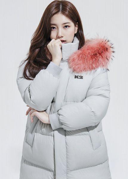 Tags: K-Pop, Bae Suzy, Serious, Coat, Wavy Hair, Fur, Fur Trim, Light Background, White Outerwear, White Background, K2