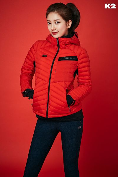 Tags: K-Pop, Bae Suzy, Blue Pants, Red Background, Red Lips, Hair Up, Ponytail, Red Outerwear, Black Eyes, Hand In Pocket, Red Jacket, Gloves