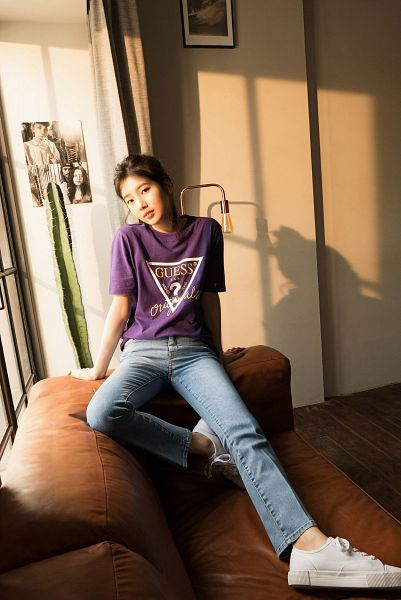 Tags: K-Pop, Bae Suzy, Hair Buns, Cactus, Single Bun, Sitting On Couch, Purple Shirt, Short Sleeves, Hair Up, Plant, Black Eyes, Jeans