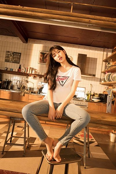 Tags: K-Pop, Bae Suzy, Sitting On Table, Head Tilt, Barefoot, Wavy Hair, Kitchen, Short Sleeves, Table, Black Eyes, Guess