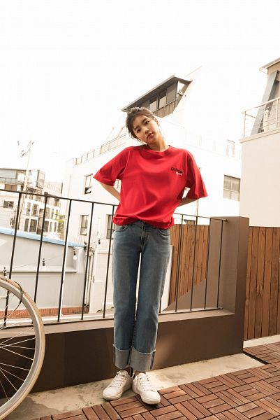 Tags: K-Pop, Bae Suzy, Bicycle, Red Shirt, Gray Pants, Short Sleeves, Serious, Black Eyes, Head Tilt, Arms Behind Back, Fence, Guess