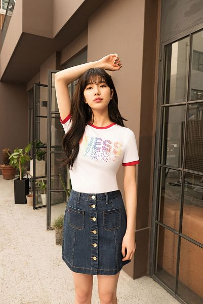 Tags: K-Pop, Bae Suzy, Serious, Black Eyes, Plant, Blue Skirt, Wavy Hair, Skirt, One Arm Up, Short Sleeves, Guess